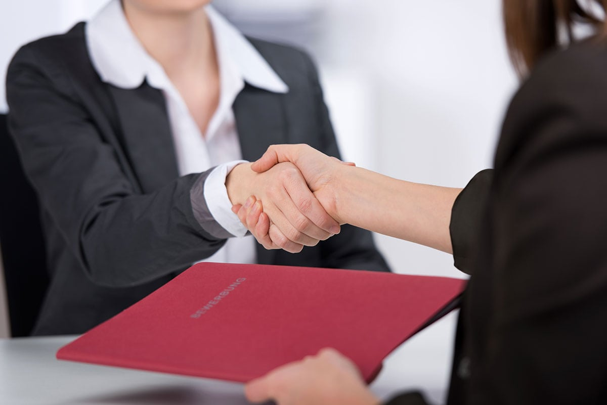 Image of two women shaking hands during a job interview