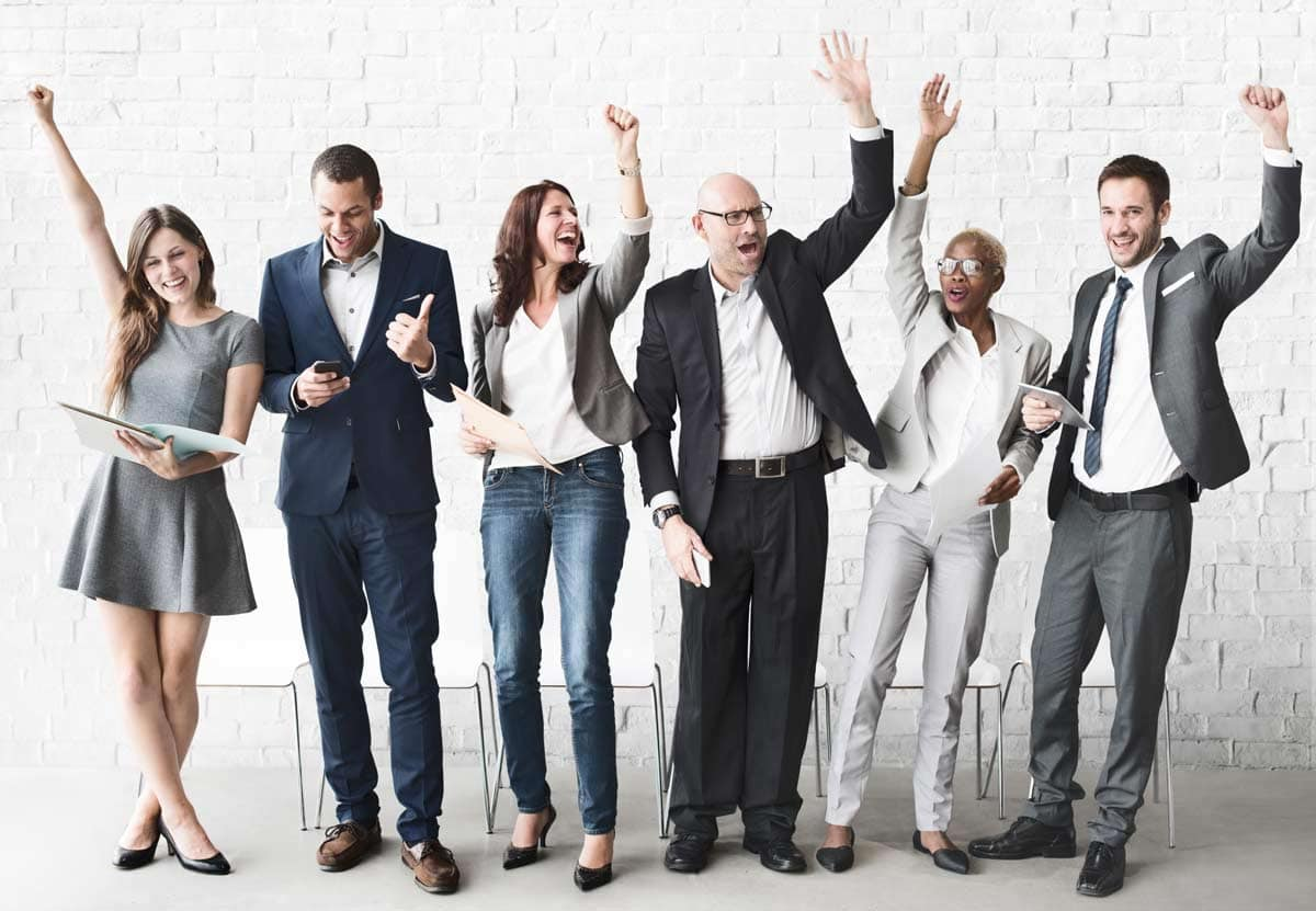Image of people cheering in business attire