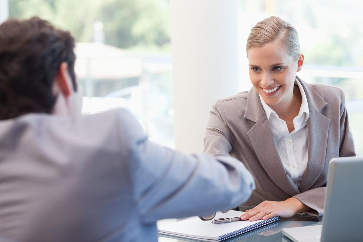Woman interviewing man for medical sales position